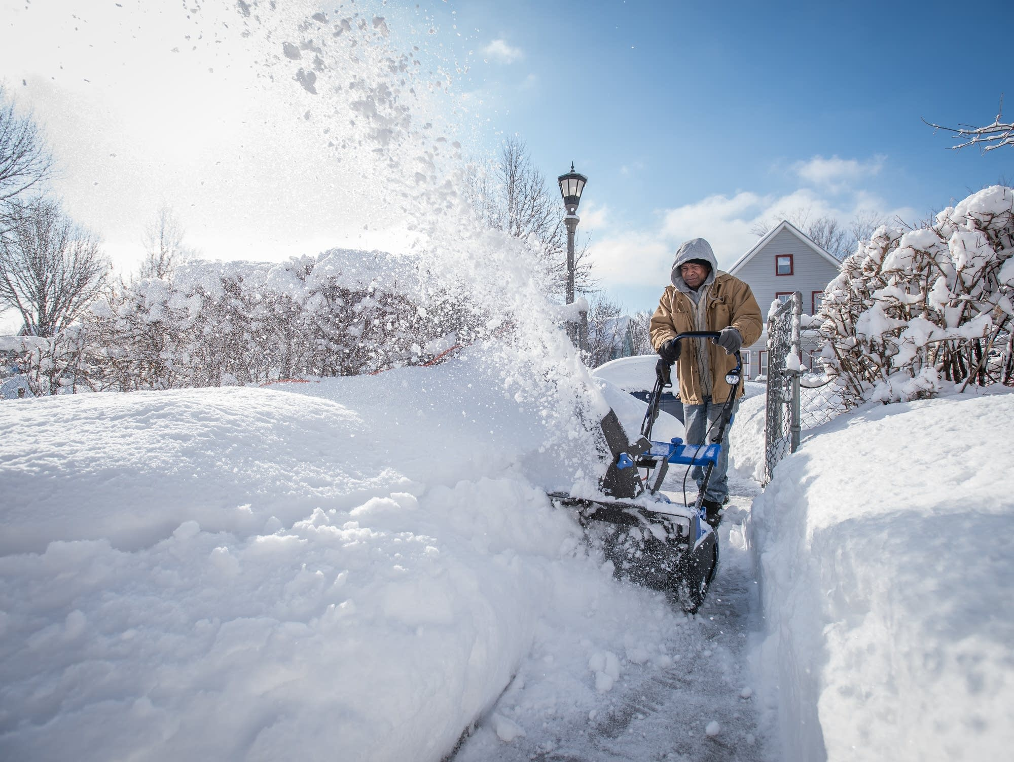 Danny Barber, 69, of St. Paul, uses a snowblower