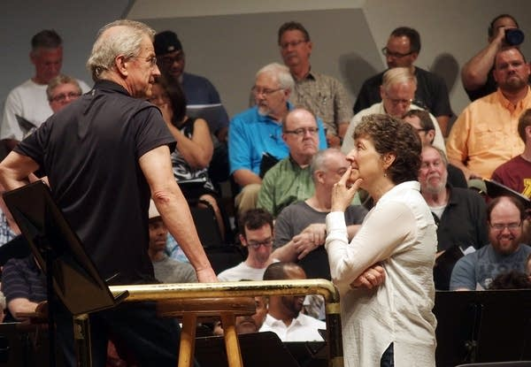 Osmo Vanska and Kathy Romey talk during a rehearsal for Music For Mandela.
