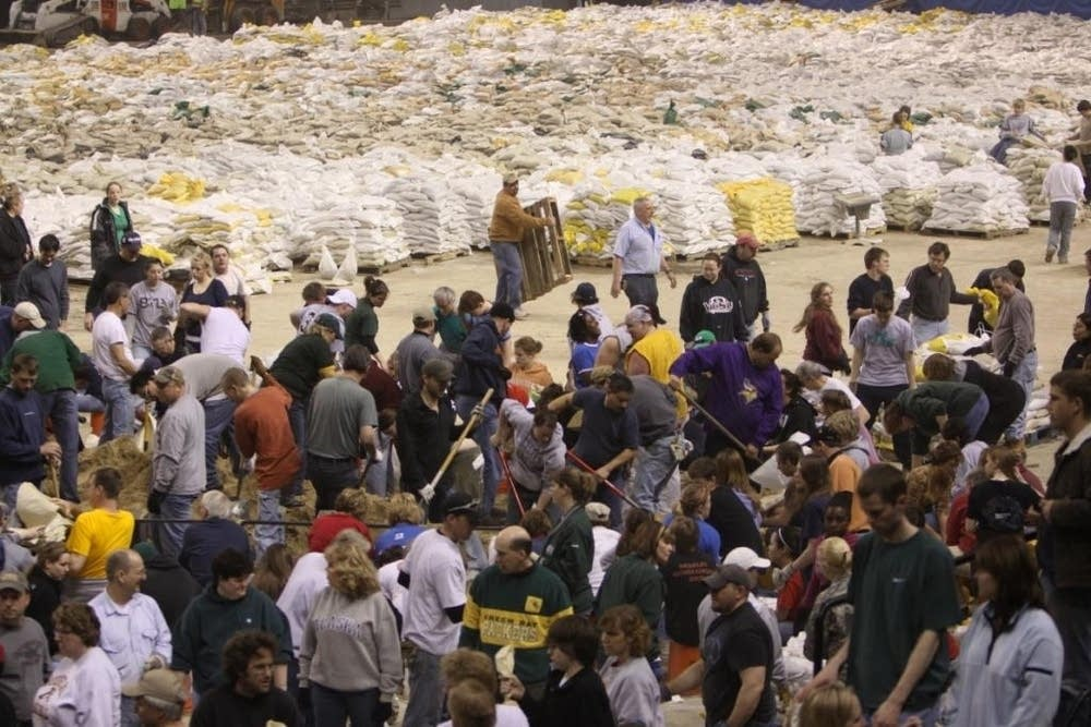 Volunteers fills sandbags at Fargo Dome