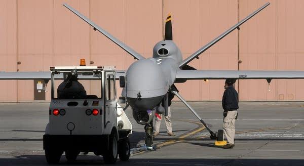 Ground crew moved the Predator B.