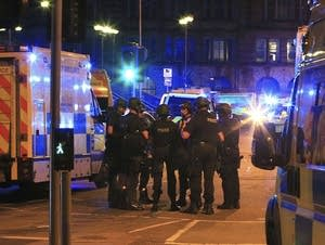 Armed police gather at Manchester Arena