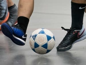 Soccer player Oo Meh, 18, practices futsal with other teammates.