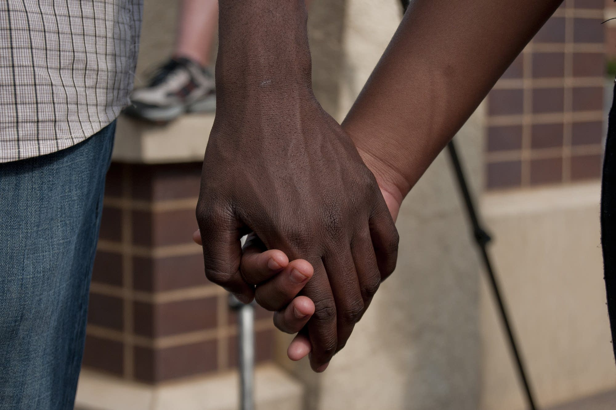 Holding hands during a prayer circle.