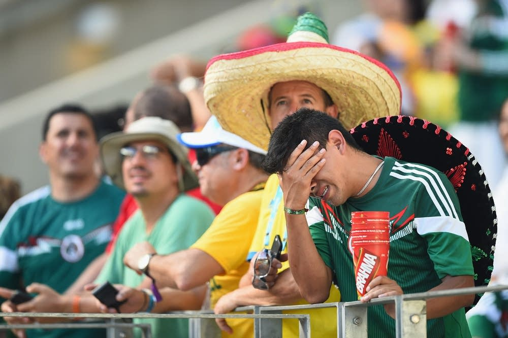 A Mexican fan shows his despair