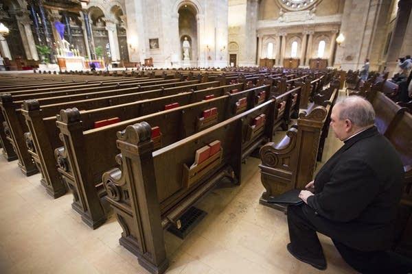 Archbishop Bernard Hebda takes a moment of prayer.