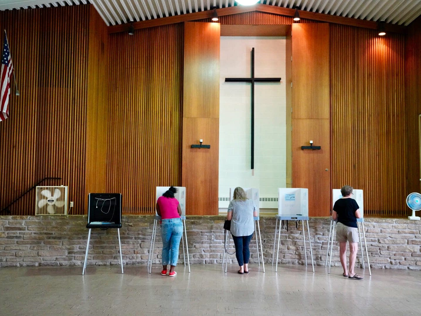 People vote at the Lutheran Memorial Church in South St. Paul.