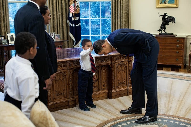 Obama let a staffer's son feel his hair.