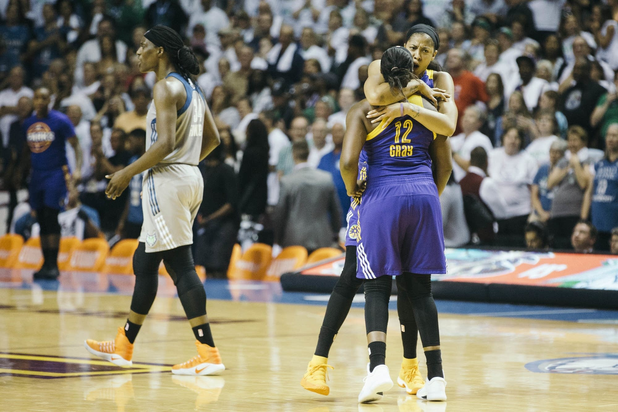 Two LA Sparks players celebrate after winning game 1.