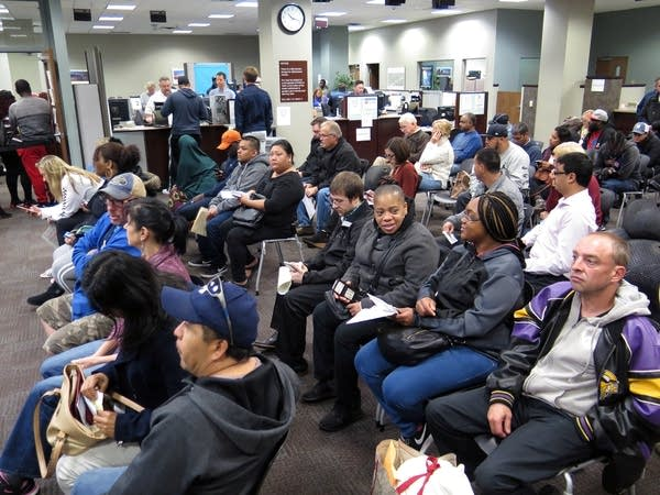 People waited in the lobby of the state Driver and Vehicle Services.
