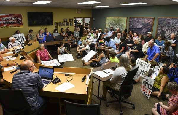 A view of a crowded city council chambers.
