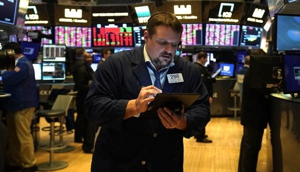Traders work during the closing bell at the New York Stock Exchange.