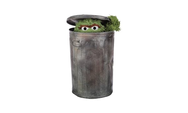 Muppet Oscar the Grouch in garbage can on white background