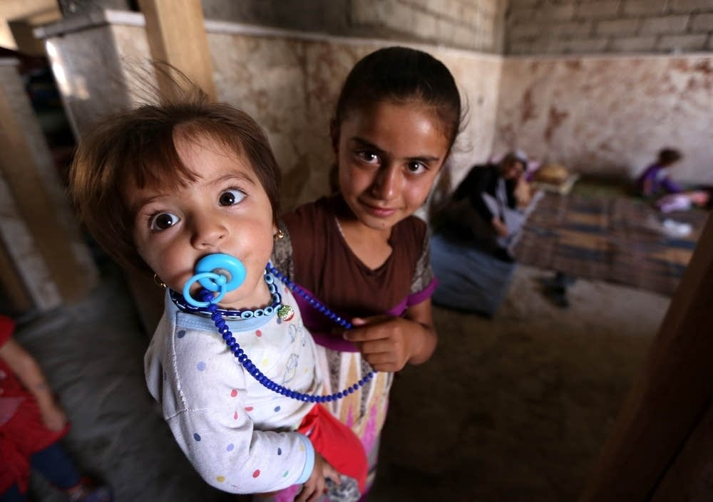 Iraqi Yazidi children who fled violence