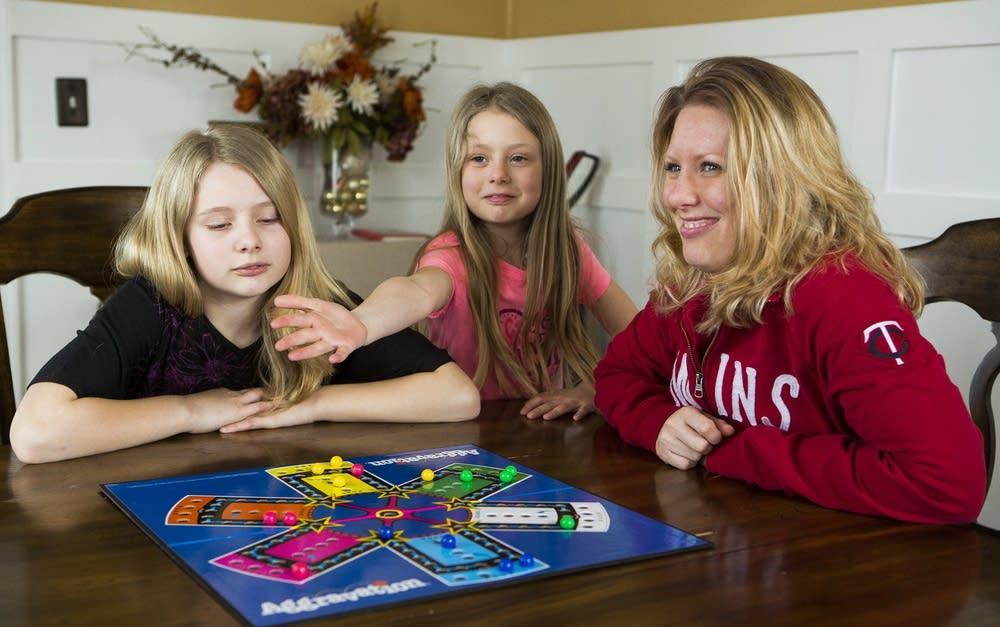 Jen Mogensen plays with her daughters.