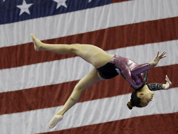 Sunisa Lee competes on the beam