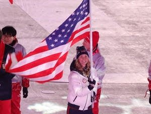 Jessie Diggins carries flag at 2018 Winter Olympic Games closing ceremony