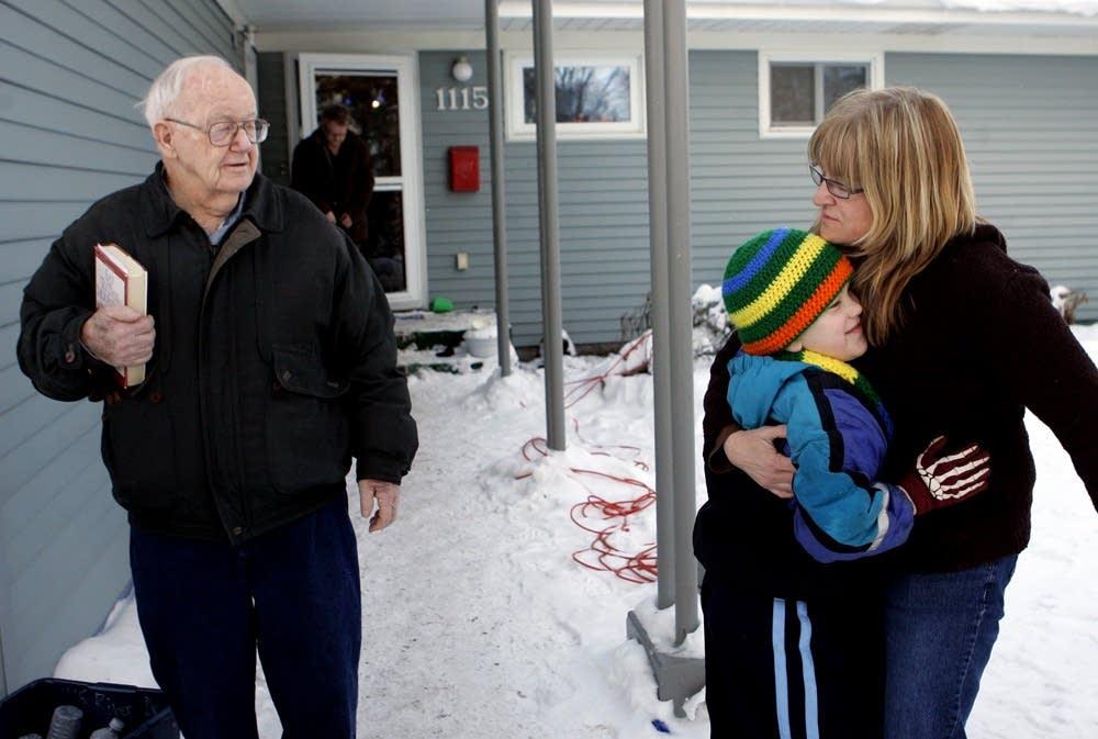 Evacuees say goodbye as families split up