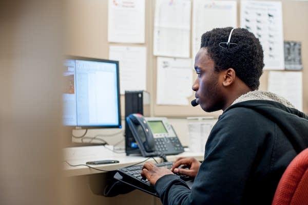 Lamin Ceesay working at his job in Minneapolis.