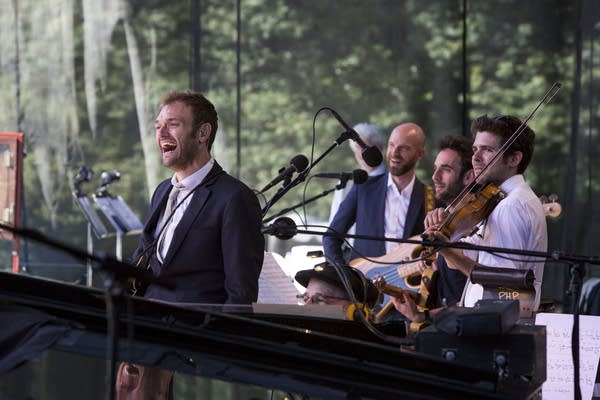 Chris Thile and the band laugh along to Dave Hill's set.