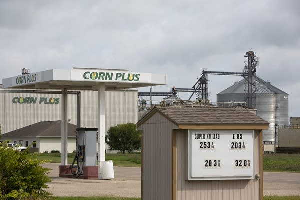 An ethanol fueling station in front of a processing plant.
