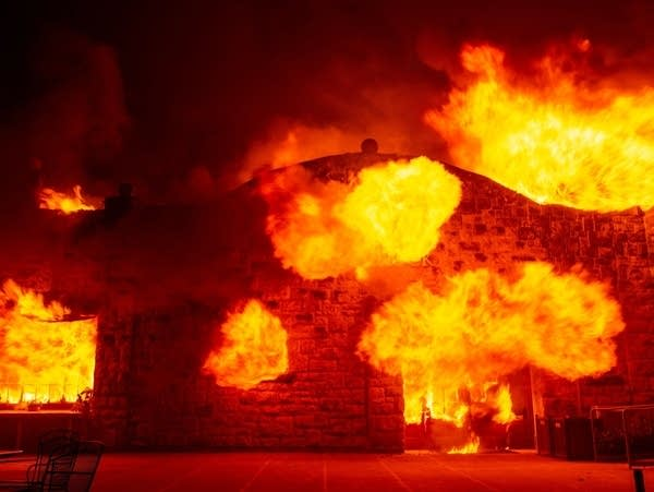 Fire explodes out the entrance of the Soda Rock Winery