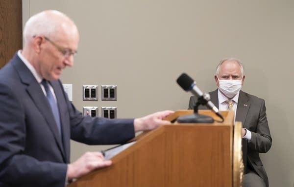 Gov. Tim Walz, right, listens as MMB Commissioner Myron Frans talks.
