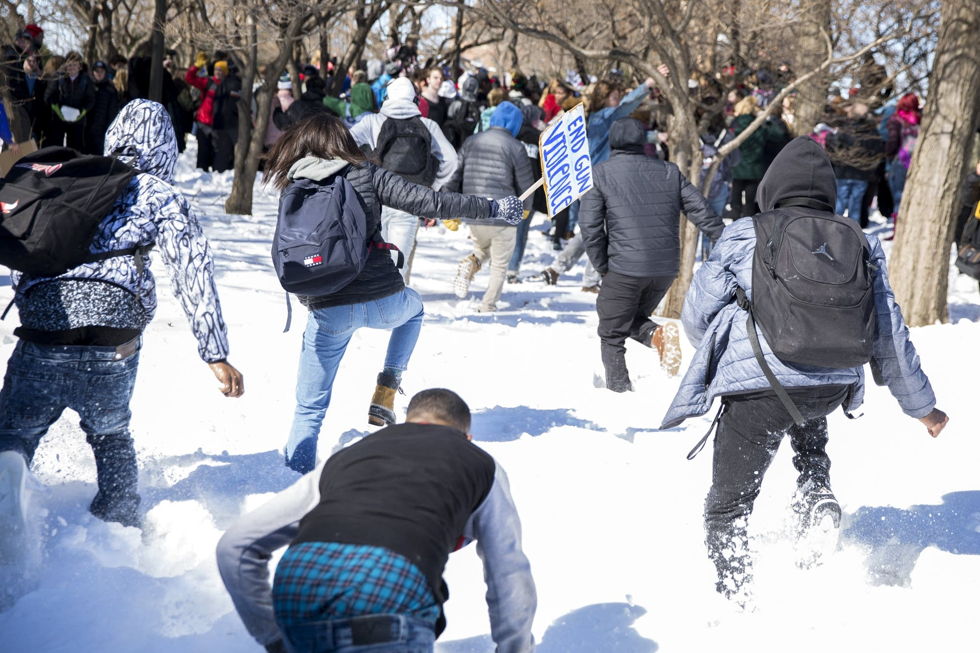 Students run through deep snow in Leif Erikson Park
