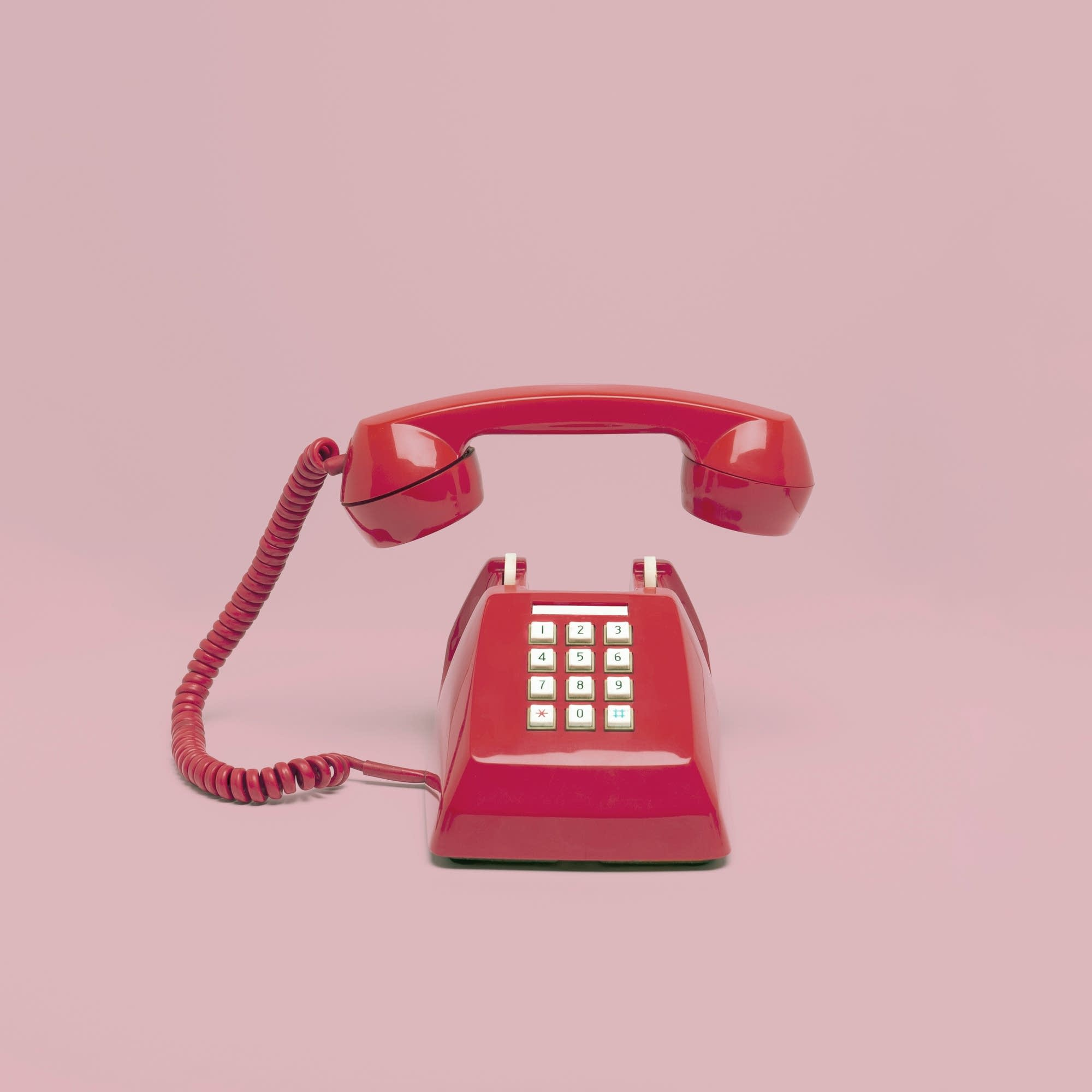 A red landline telephone