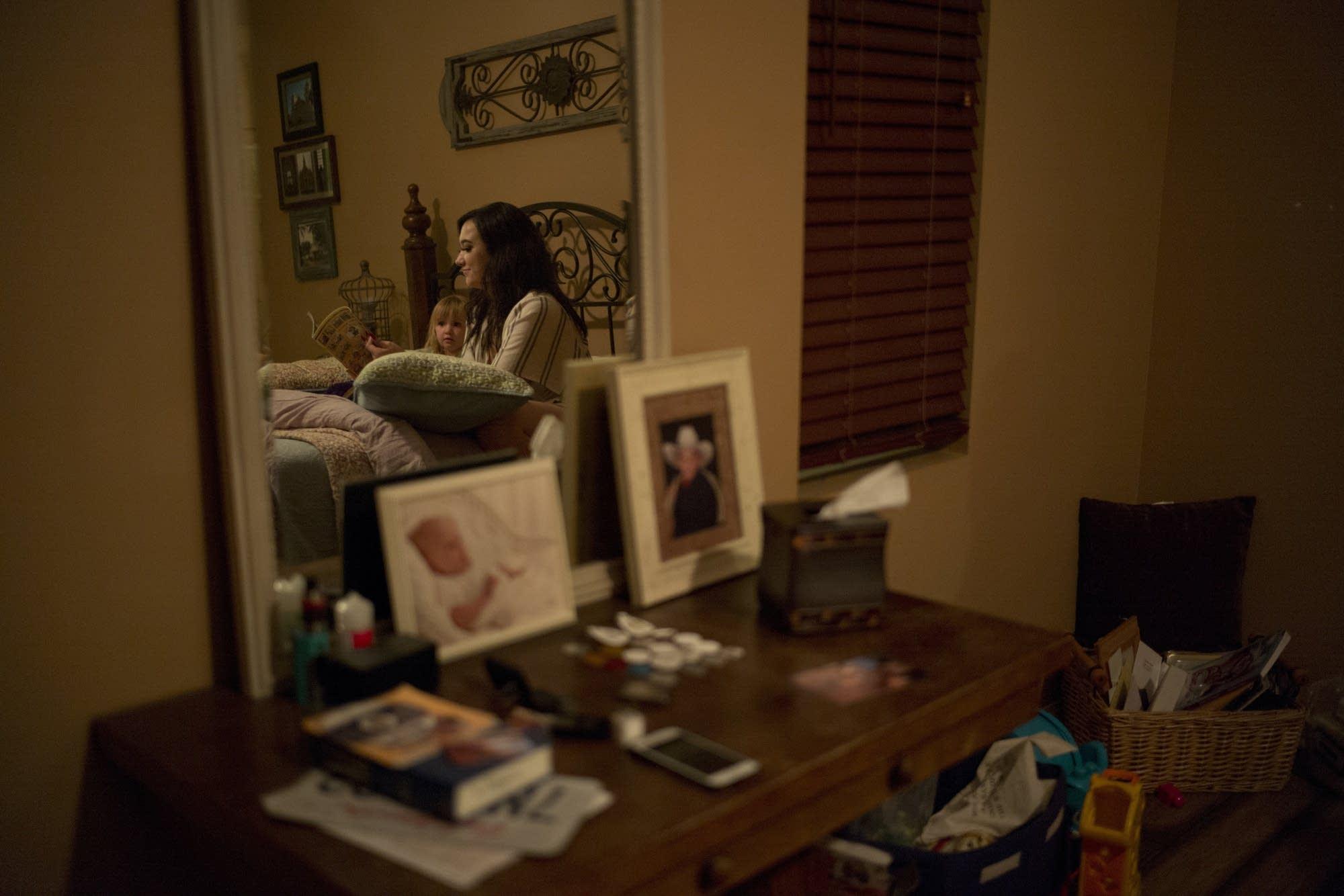 Megan Dealbert reads a bedtime story to her daughter Aubrey.