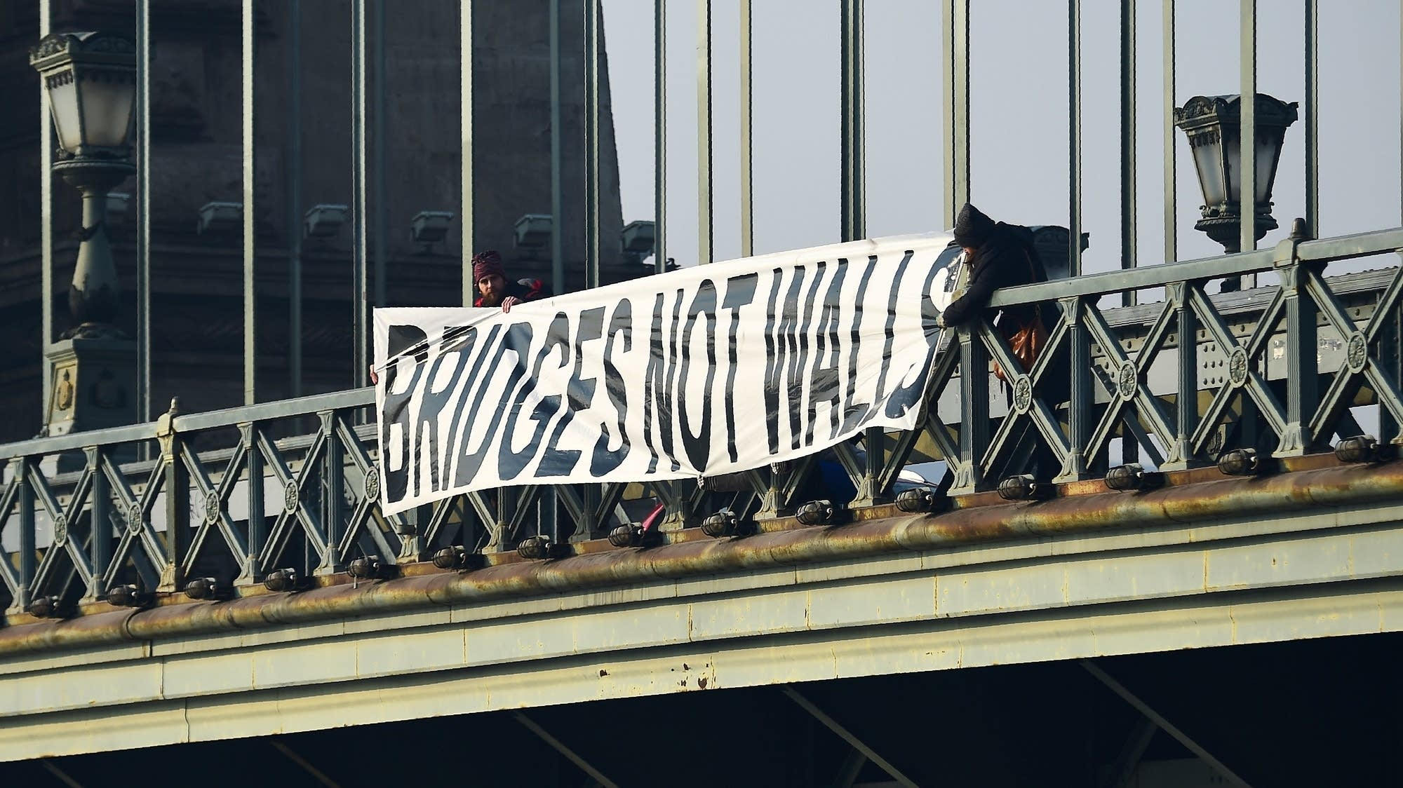 Budapest, Hungary: Participants hold banner reading 'Bridges not  walls.'