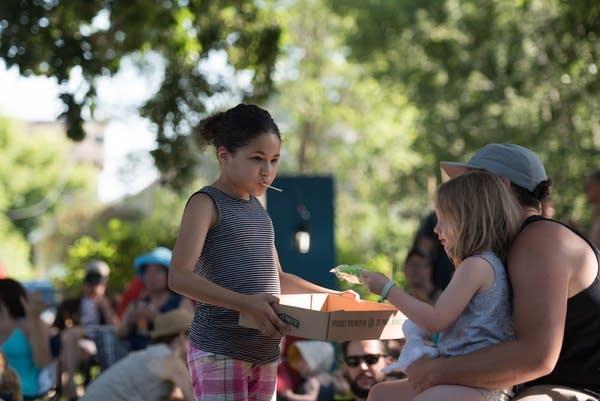 Grace Hawkins hands out popsicles.
