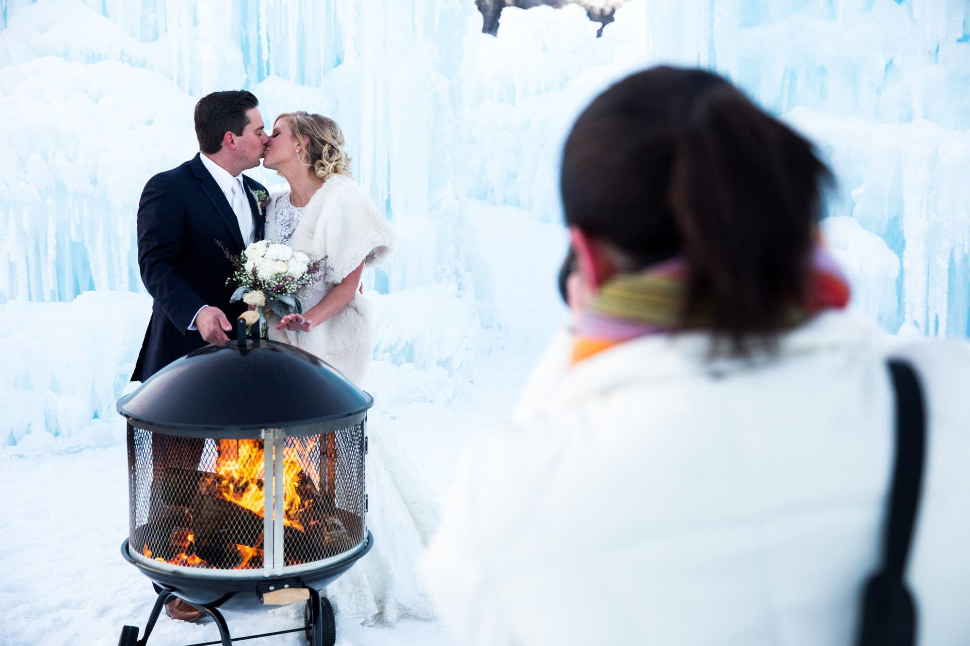 Newlyweds share a frigid kiss for the camera.