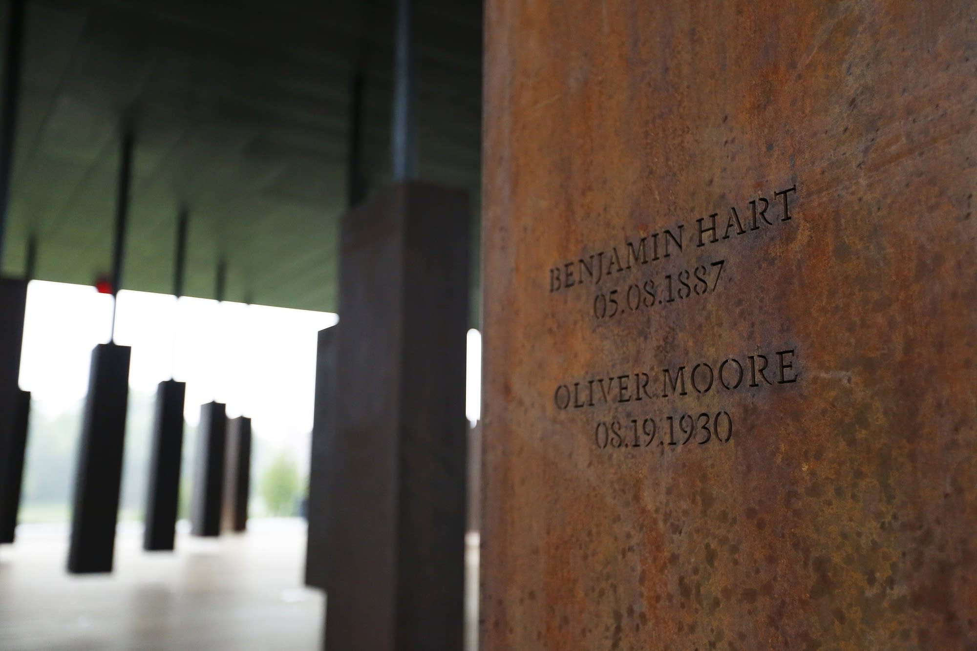 Names of lynching victims are carved in metal at the National Memorial.