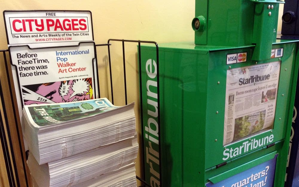 A City Pages rack sat next to the Star Tribune.