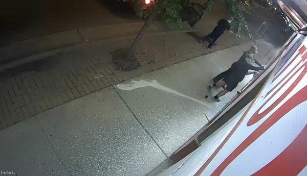 vandals spray paint the side of a building