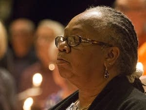 Rev. Babette Chatman of Redeemer Lutheran holds a candle at the vigil.