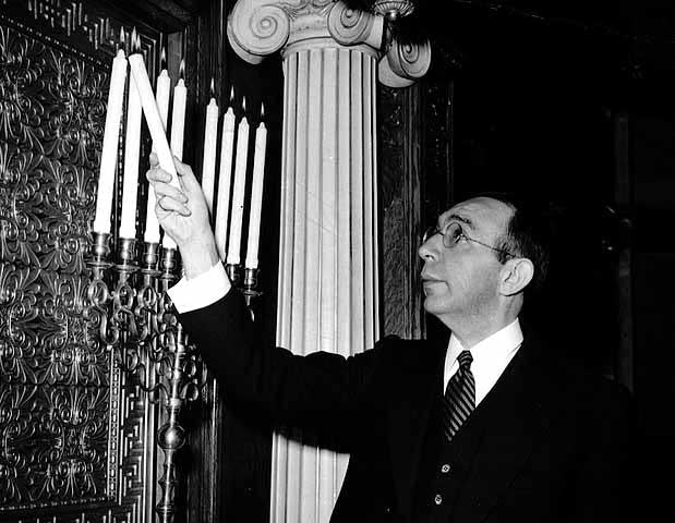 Rabbi Harry Margolis lights the menorah, 1943