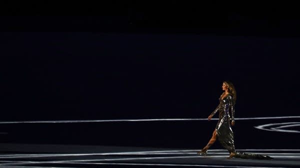 Gisele Bundchen walks onto the stage.