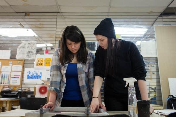 A Juxtaposition screen printing apprentice