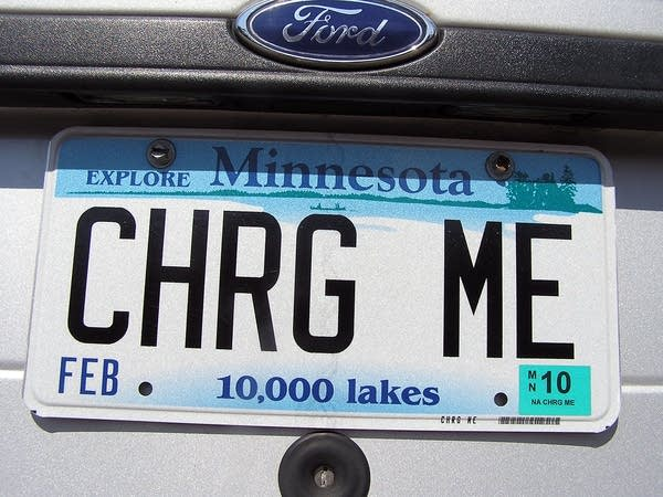 "A license plate on a vehicle reads, ""charge me."""