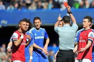 16438d 20140324 arsenal gibbs andre marriner red card