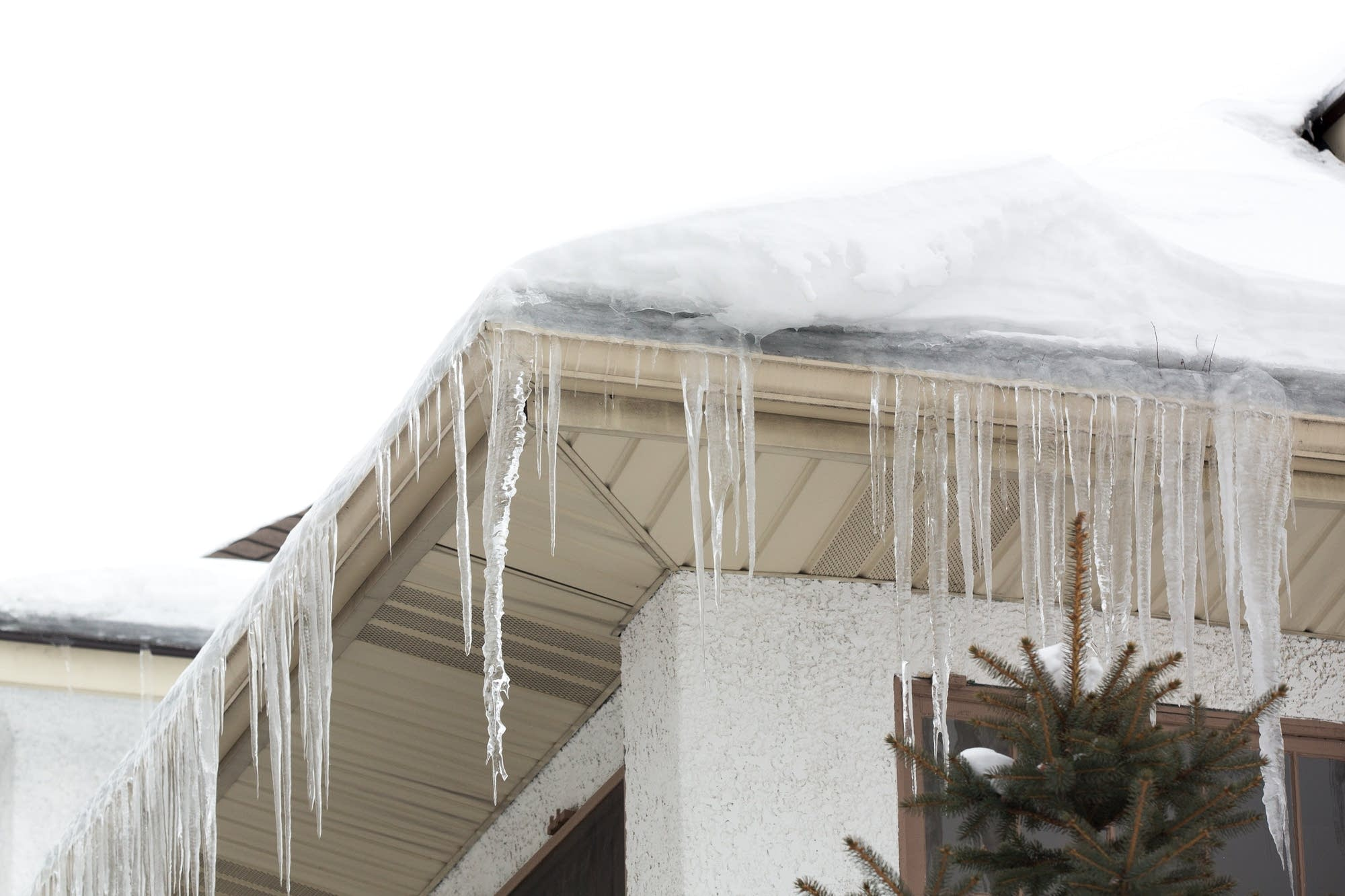 An ice dam overwhelms the gutters of a south Minneapolis home.