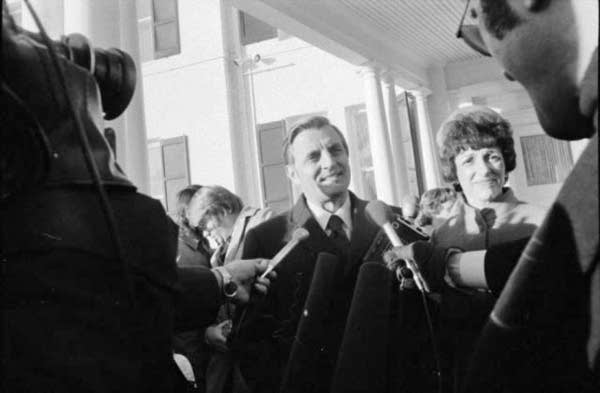 Walter Mondale speaks to reporters on the day of his inauguration.