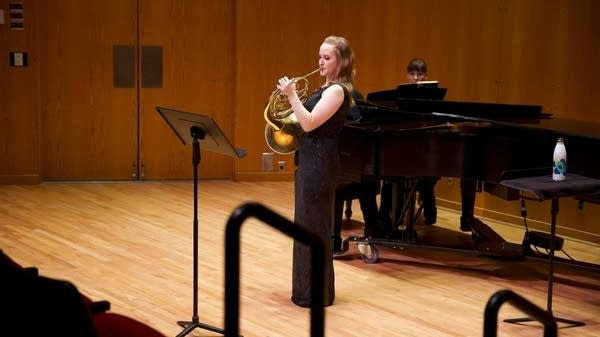 Emily performing her senior horn recital at the U of MN