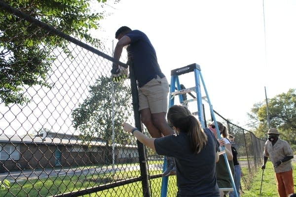 Scientists from the University of Alabama-Birmingham install air monitors near the Collegeville Center complex.