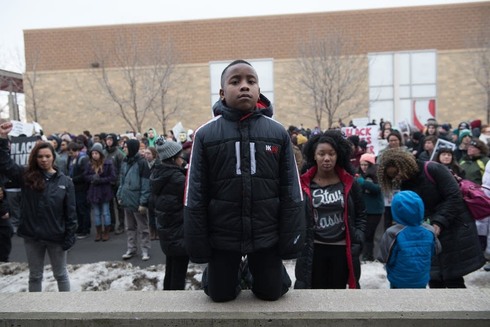 Obinna Oramalu, 9, of Brooklyn Park, at the march.