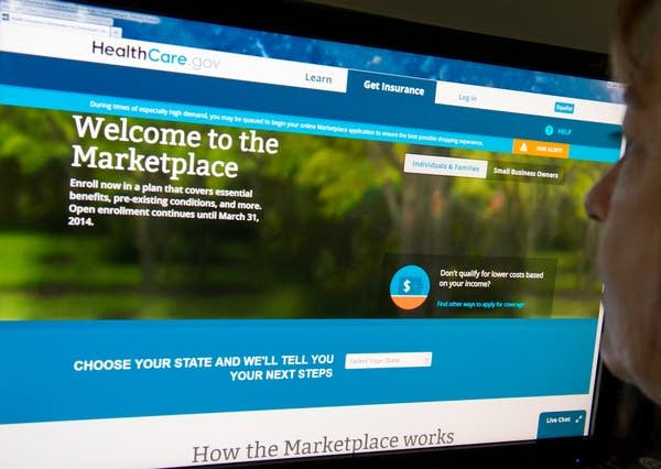 A woman reading the HealthCare.gov insurance marketplace internet site