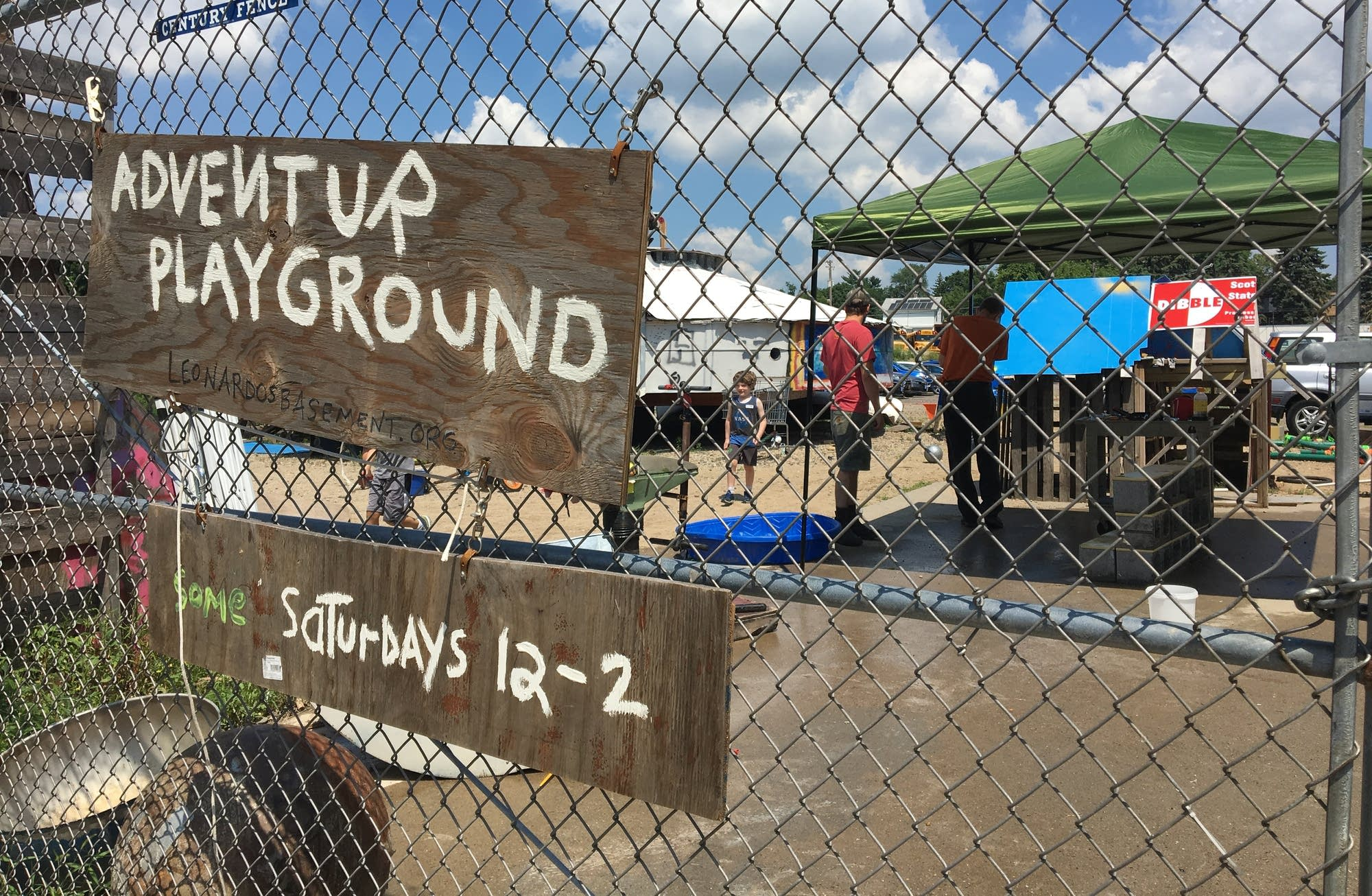 The Adventure Playground lies behind a chain-link fence in Mpls.