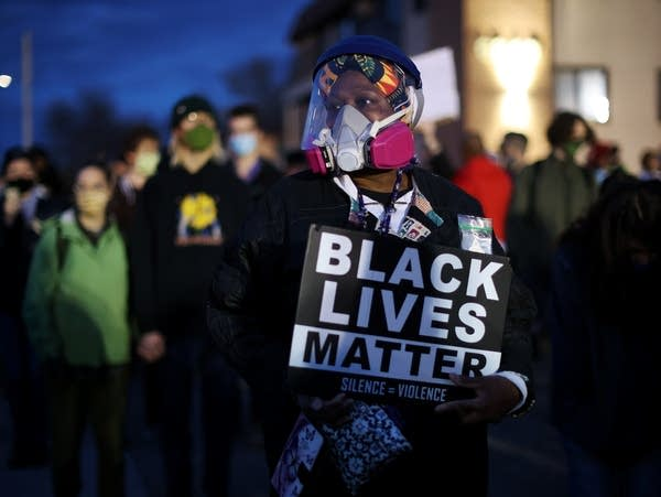 A demonstrator holds a sign during a protest