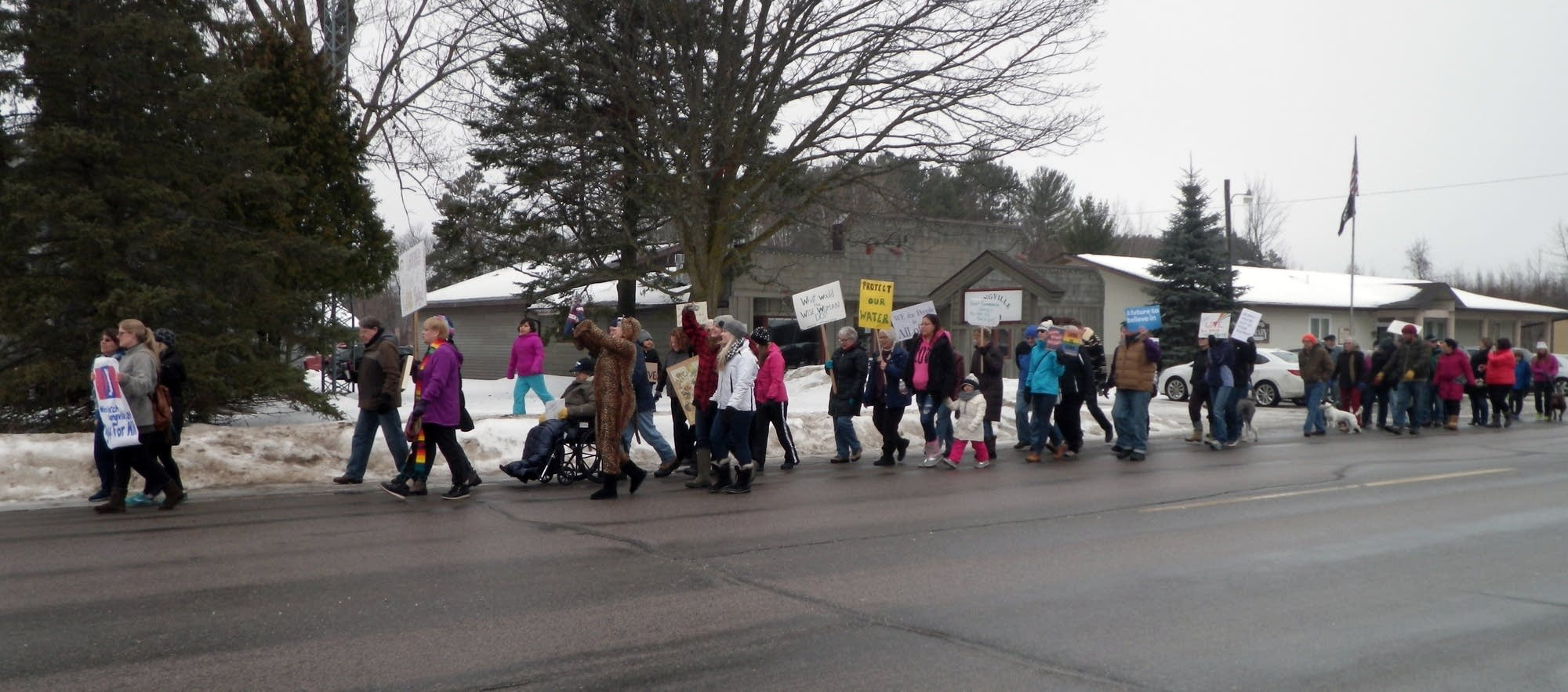 Demonstrators march in Longville